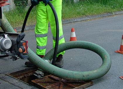 Who to hire to clean a storm water drain